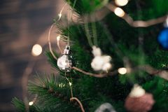 Christmas decorations on the tree with blurred background royalty free stock photos