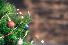Christmas decorations on the tree with blurred background royalty free stock images