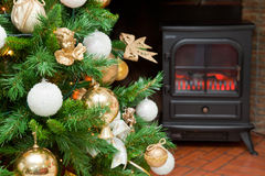 Christmas decorations on a tree. With the bottom of a fireplace Stock Photos