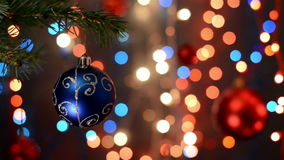 Christmas decorations on tree, branch, bokeh background, out of focus lights stock video