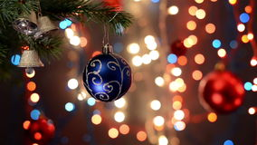 Christmas decorations on tree, branch, bokeh background, out of focus lights stock footage