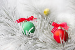 Christmas decorations on a tree in frost Royalty Free Stock Photo