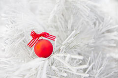 Christmas decorations on a tree in frost Stock Photo