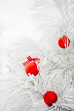Christmas decorations on a tree in frost Royalty Free Stock Images