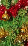 Christmas decorations for tree in gold glitter and red. With sparkles and tinsel Stock Photos
