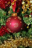 Christmas decorations for tree in gold glitter and red. With sparkles and tinsel Stock Images