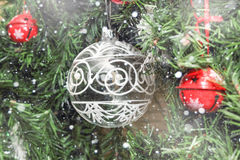 Christmas decorations on tree under snow Royalty Free Stock Image