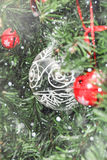 Christmas decorations on tree under snow Royalty Free Stock Images