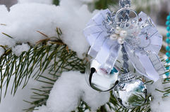 Christmas decorations on the tree in winter wood. Stock Photography