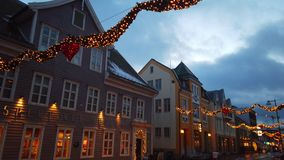 Christmas decorations in Tromso town. Christmas lights and decorations hanging between buildings in the centre of Tromso town, Northern Norway stock footage