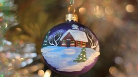 Christmas decorations. Two balls with imitation of falling snow stock footage