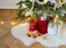 Christmas decorations under the Christmas tree stock photo