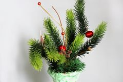 Christmas decorations in a vase on a white background royalty free stock images