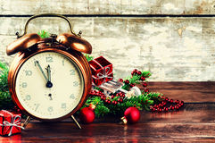 Christmas decorations with vintage alarm clock Royalty Free Stock Images