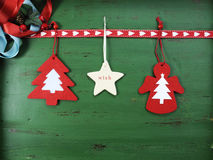 Christmas decorations on vintage green wood background, with hanging felt ornaments. Christmas holiday background with hanging red, white, festive decorations Stock Image