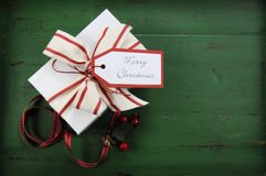 Christmas decorations on vintage green wood background with white gift Royalty Free Stock Photography