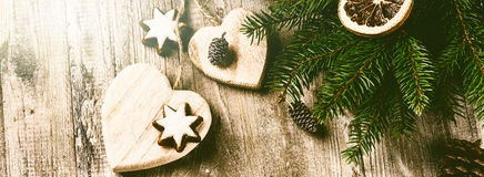 Christmas decorations in vintage style over old wood background Royalty Free Stock Images