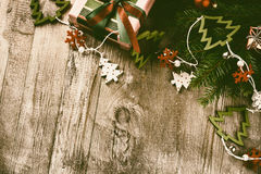 Christmas decorations in vintage style over old wood background Stock Photo
