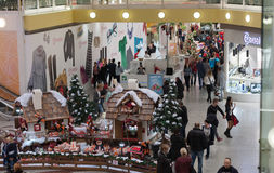 Christmas  decorations and walking people  at shopping center Ol Royalty Free Stock Image