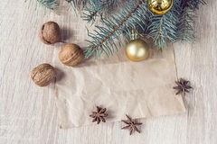Christmas decorations, walnuts and anise with a blank paper Royalty Free Stock Images