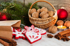 Christmas decorations with walnuts, spices and gingerbread cooki Stock Photo
