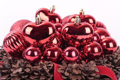 Christmas decorations  on white. Red Christmas decorations and pinecones on white Royalty Free Stock Image