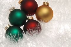 Christmas decorations on white garland Stock Images