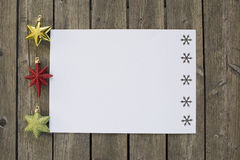 Christmas decorations on white sheet of paper Royalty Free Stock Photo