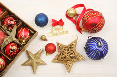 Christmas decorations on white wood Royalty Free Stock Photography