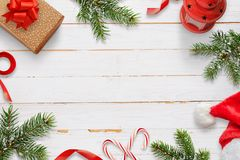 Christmas decorations on white wooden table. Free space in the middle for text. Top view Stock Images