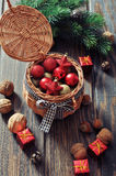 Christmas decorations in wicker basket Stock Image