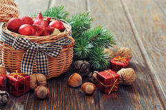 Christmas decorations in wicker basket Stock Images