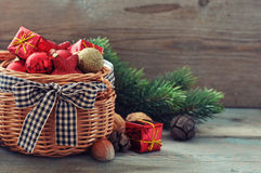 Christmas decorations in wicker basket Royalty Free Stock Photography
