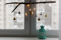 Christmas decorations on a window sill. Christmas decoration and lantern with candle on a window sill Stock Photography