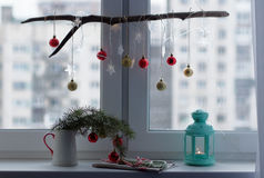 Christmas decorations on a window sill. Christmas decoration and lantern with candle on a window sill Stock Images