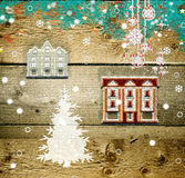 Christmas decorations. Wood background with tree and Christmas houses Stock Photo