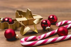 Christmas Decorations on Wooden Background Candy Cane Christmas Toys Holiday Festive Background or Card Horizontal.  stock photos