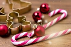 Christmas Decorations on Wooden Background Candy Cane Christmas Toys Holiday Festive Background or Card Horizontal Toned.  stock images