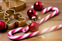 Christmas Decorations on Wooden Background Candy Cane Christmas Toys Holiday Festive Background or Card Horizontal Toned.  stock photography