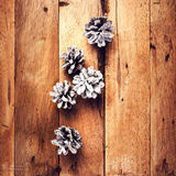 Christmas  decorations on wooden background. Pine cones on old w Royalty Free Stock Images