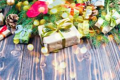 Christmas decorations. Wooden background and table. Gifts and baubles. stock photos