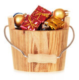 Christmas decorations in wooden bucket Royalty Free Stock Photography