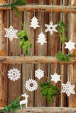 Christmas decorations on a wooden fence Stock Image