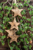 Christmas decorations wooden stars and pine tree branches Royalty Free Stock Photos
