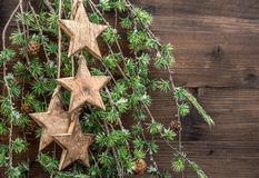 Christmas decorations wooden stars and pine tree branches Stock Photo