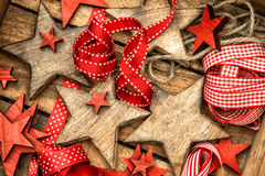 Christmas decorations wooden stars and red ribbons Royalty Free Stock Photos