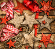 Christmas decorations wooden stars and red ribbons Stock Images