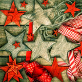 Christmas decorations wooden stars and red ribbons Stock Photos
