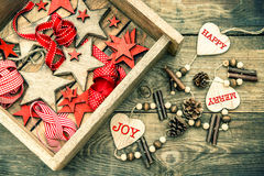 Christmas decorations wooden stars and red ribbons. retro style Stock Image