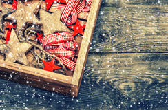 Christmas decorations wooden stars and red ribbons Royalty Free Stock Photography